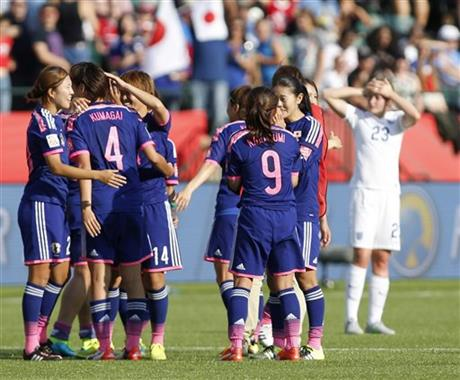 Japan players celebrate a 2-1 win as England's Ellen White (23) watches following a semifinal in the FIFA Women's World Cup soccer tournament, Wednesday, July 1, 2015, in Edmonton, Alberta, Canada. Japan won 2-1. AP