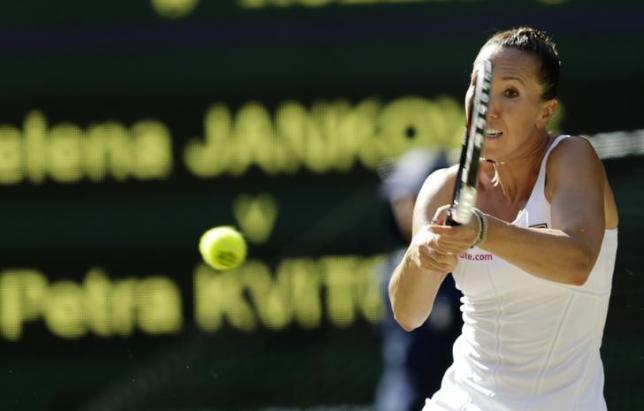 Jelena Jankovic of Serbia hits a shot during her match against Petra Kvitova of the Czech Republic at the Wimbledon Tennis Championships in London, July 4, 2015.                  REUTERS/Henry Browne
