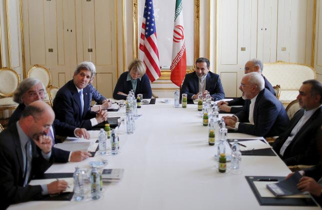 U.S. Secretary of State John Kerry (centre L) meets Iranian Foreign Minister Mohammad Javad Zarif (2nd R) at a hotel in Vienna, Austria July 1, 2015. REUTERS/Carlos Barria