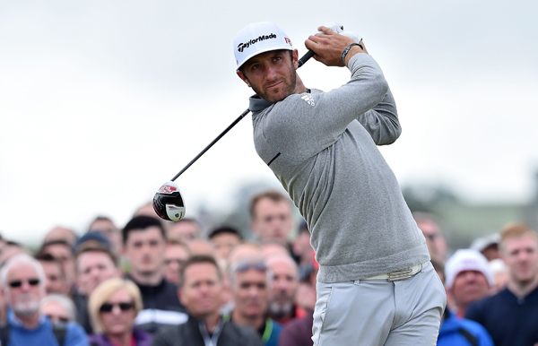 Dustin Johnson of the US watches his drive from the fourth tee during the first round of the British Open on the Old Course at St Andrews in Scotland on Thursday. Photo: AFP