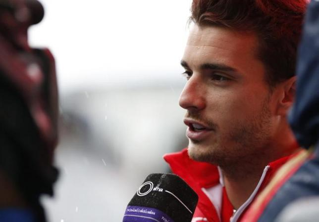 Marussia Formula One driver Jules Bianchi of France speaks to the media after a news conference at the Suzuka circuit October 2, 2014. REUTERS/Yuya Shino/Files