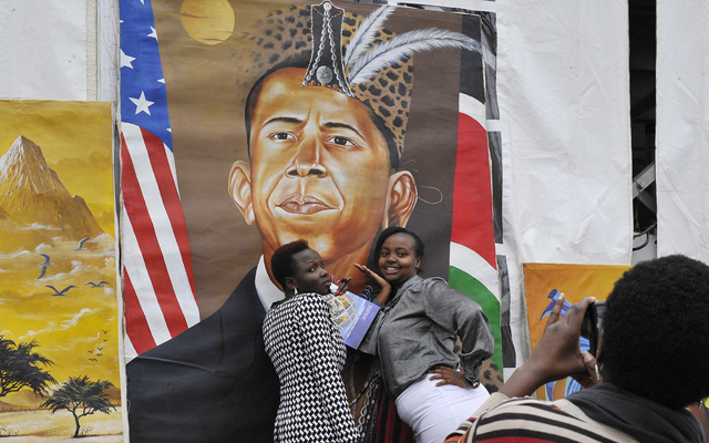 Kenyan women pose for a photograph in front of a painted artwork depicting US President Barack Obama at the Pre-Global Entrepreneurship Summit in Nairobi, on the eve of Obama's visit to Kenya, on Thursday. Photo: AFP