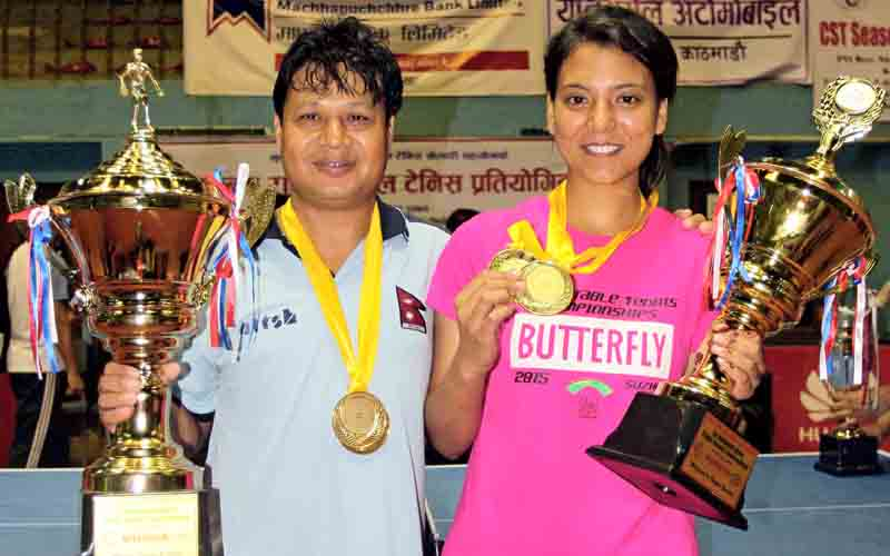 Rajendra Kapali (left) of TAC and Elina Maharjan of NPC pose with trophies and medals during the prize distribution ceremony of the National Open Table Tennis Championship on Saturday.