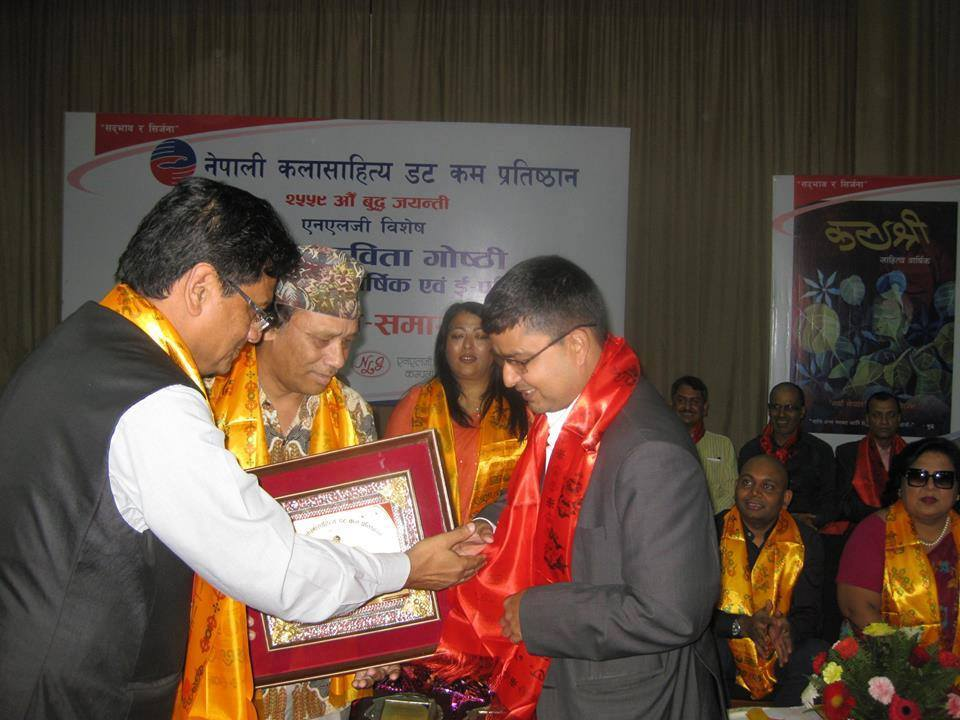 Chancellor at the Nepal Academy of Music and Drama, Sarubhakta honouring poet and essayist Keshab Sigdel with a cash prize of Rs 11,000 amid a special function in the Capital on Thursday, June 24, 2015. Photo Courtesy: Keshab Sigdel