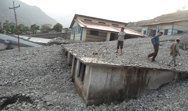 FILE: A building of Kolti Primary Health Centre in Bajura district damaged by landslides in May-June last year. The health centre still operates under the continuous threat of landslides. Photo: Prakash Singh