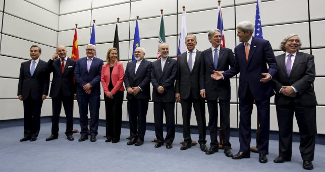 (From L to R) Chinese Foreign Minister Wang Yi, French Foreign Minister Laurent Fabius, German Foreign Minister Frank Walter Steinmeier, European Union High Representative for Foreign Affairs and Security Policy Federica Mogherini, Iranian Foreign Minister Mohammad Javad Zarif, Head of the Iranian Atomic Energy Organization Ali Akbar Salehi, Russian Foreign Minister Sergey Lavrov, British Foreign Secretary Philip Hammon, U.S. Secretary of State John Kerry and U.S. Secretary of Energy Ernest Moniz pose for a group picture at the United Nations building in Vienna, Austria July 14, 2015. REUTERS/Carlos Barria