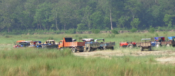 Tractors being used for mining in the Lalbakaiya River, in Nijgadh, Bara, on Monday. tPhoto: THT