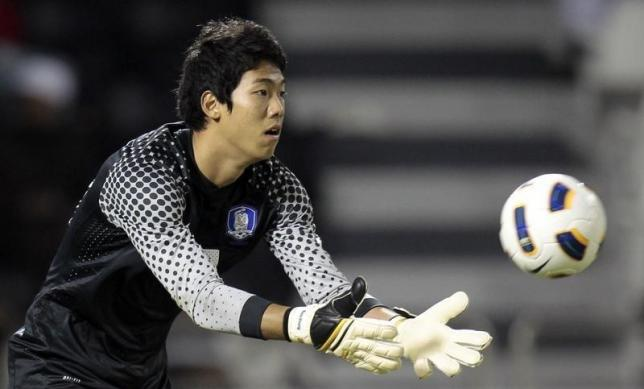 South Korea's goalkeeper Lee Bum-young saves the ball during their 2012 London Olympic Games third qualifying round soccer match against Qatar at the Al-Sadd Stadium in Doha November 23, 2011.  REUTERS/Fadi Al-Assaad/Files