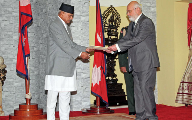 Non-residential Ambassador of Georgia to Nepal, Levan Nizharadze, handing over the Letter of Credence to the President Dr. Ram Baran Yadav at the latter's office in Shital Niwas on Thursday, July 23, 2015. Courtesy: President's Secretariat