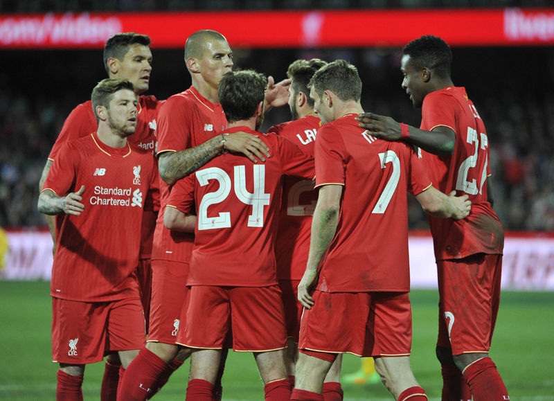 Liverpool FC players celebrate after a goal during the international friendly football match between Adelaide United and English Premier League side Liverpool in Adelaide on July 20, 2015. Photo: AFPnnn
