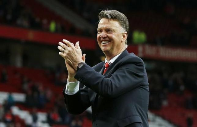 nManchester United manager Louis van Gaal applauds fans during a lap of honour after the Manchester United v Arsenal game on May 17.n