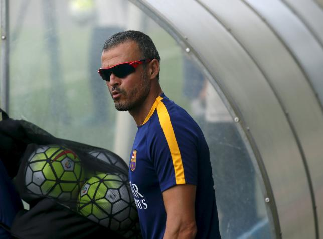 Barcelona's soccer coach Luis Enrique attend a training session at Joan Gamper training camp, near Barcelona, Spain, July 15, 2015. REUTERS/Albert Gea