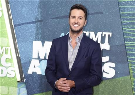 FILE - In this June 10, 2015 file photo, Luke Bryan arrives at the CMT Music Awards at Bridgestone Arena, in Nashville, Tenn. Bryan is launching a new mobile app with interactive features, exclusive content and live-streaming for fans. AP