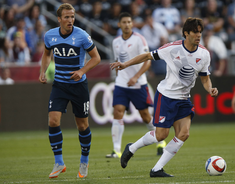 MLS All-Star midfielder Kaka, right, works the ball past Tottenham Hotspur forward Harry Kane during the first half of the MLS All-Star soccer game Wednesday, July 29, 2015, in Commerce City, Colo.