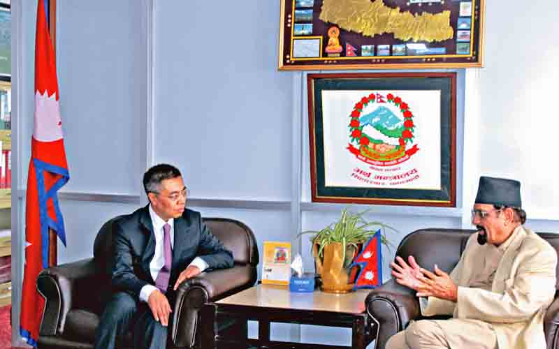 Finance Minister Ram Sharan Mahat having a discussion with Zhang Xiangchen, Deputy International Trade Representative at Ministry of Commerce, China, in Kathmandu, on Thursday. Photo: THT