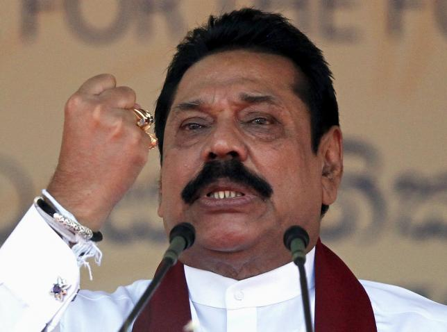 Sri Lanka's former president Mahinda Rajapaksa, who is contesting in the upcoming general election, speaks during the launch ceremony of his manifesto, in Colombo July 28, 2015. REUTERS/Dinuka Liyanawatte