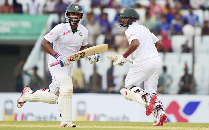 Bangladesh's Mohammad Mahmudullah (right) and his teammate Tamim Iqbal run between the wickets during the second day of their first Test match against South Africa at the Zahur Ahmed Chowdhury Stadium in Chittagong on Wednesday. Photo: AFP
