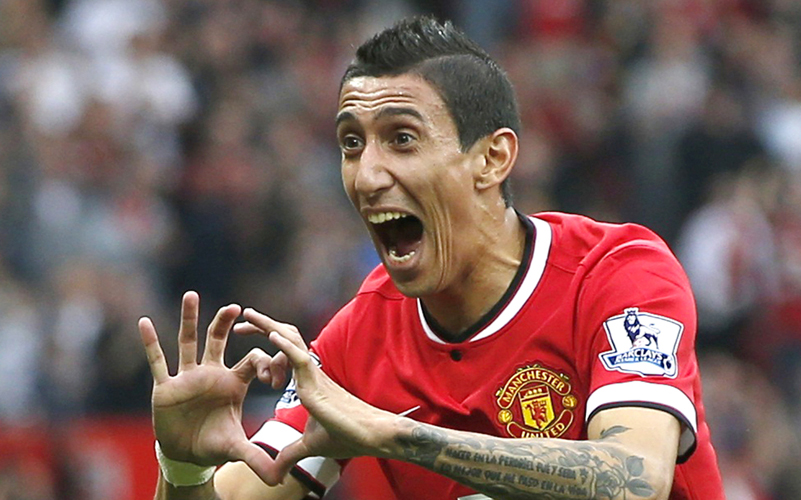 Manchester United's Angel Di Maria celebrates after scoring a goal against Queens Park Rangers during their English Premier League soccer match at Old Trafford in Manchester, northern England September 14, 2014. Photo: Reuters/File