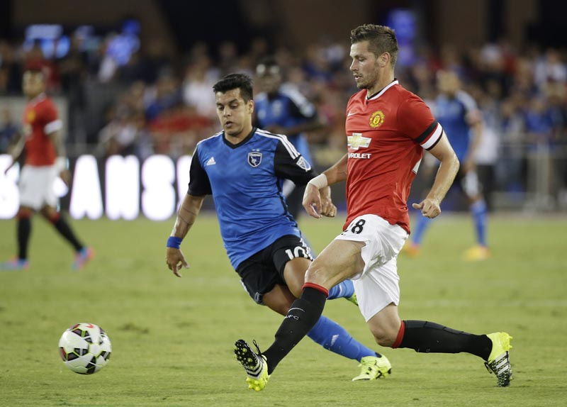 Manchester United midfielder Morgan Schneiderlin, right, and San Jose Earthquakes midfielder Matias Perez Garcia vie for the ball during the first half of an International Champions Cup soccer match Tuesday, July 21, 2015, in San Jose, Calif. Photo: AP