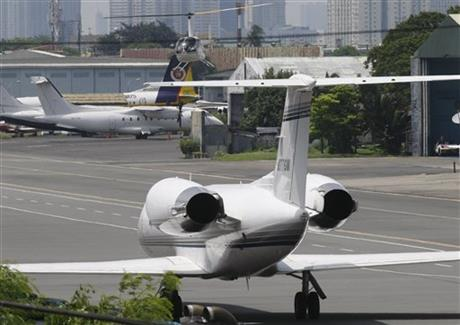 A Gulf Stream private jet chartered by Grammy award-winning singer Chris Brown, sits at the end of a taxiway housing private hangars of the Manila Domestic Airport at suburban Pasay city, south of Manila, Philippines Thursday, July 23, 2015. AP