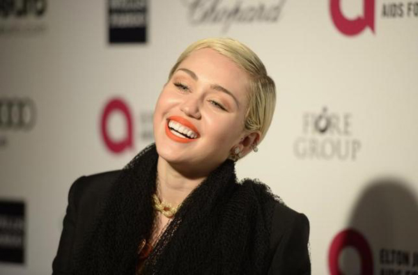 Singer Miley Cyrus arrives at the 2015 Elton John AIDS Foundation Oscar Party in West Hollywood, California February 22, 2015. Photo: Reuters