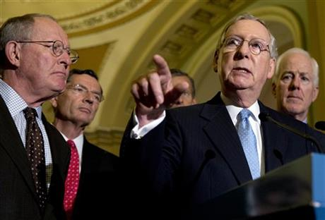 Senate Majority Leader Mitch McConnell of Ky., joined by from left, Sen. Lamar Alexander, R-Tenn., Sen. John Barrasso, R-Wy., Sen. John Thune, R-S.D., and Sen. John Cornyn, R-Texas., speaks to media after a policy luncheon on Capitol Hill in Washington, Wednesday, July 8, 2015. AP