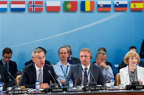 NATO Secretary General Jens Stoltenberg, left, talks during a North Atlantic Council Meeting at NATO headquarters in Brussels on Tuesday July 28, 2015. For just the fifth time in its 66-year history, NATO ambassadors met in emergency session Tuesday to gauge the threat the Islamic State extremist group poses to Turkey, and the debated actions Turkish authorities are taking in response. AP