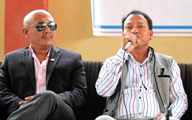 Newly-appointed Member Secretary of National Sports Council Keshav Kumar Bista (right) speaks as Vice-president Lama Tendi Sherpa looks on during a press conference in Kathmandu on Tuesday. Photo: THT