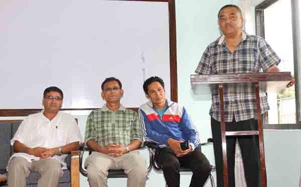 NOC President Dhruba Bahadur Pradhan speaks as General Secretary Jeevan Ram Shrestha (left), karate chief coach Mahesh Shrestha (second from left) and coach Deepak Shrestha look on during a gathering in Lalitpur on Friday.Photo: THT