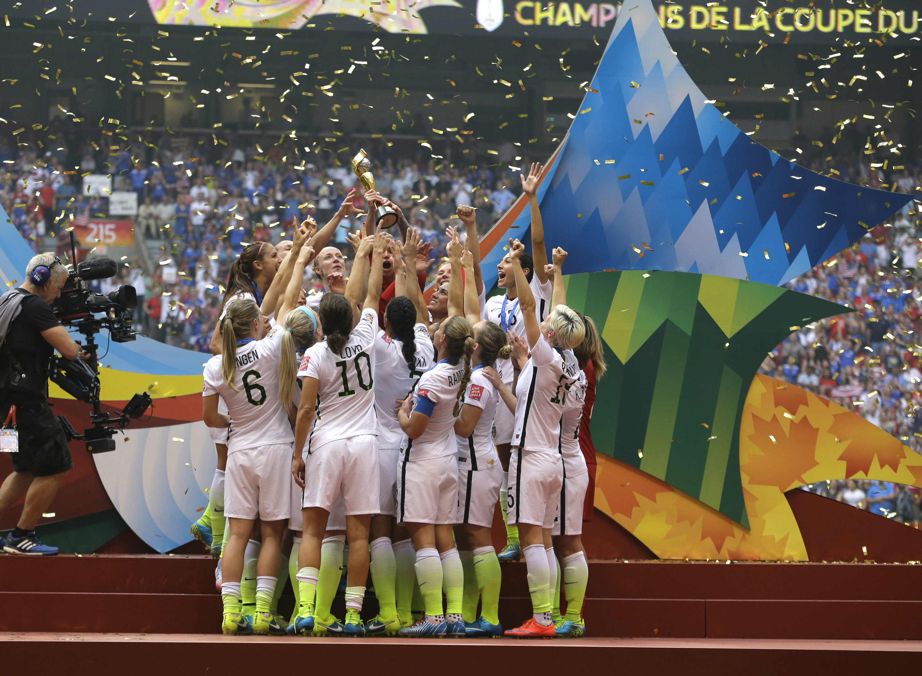 In this July 5, 2015 file photo, confetti floats down as the United States Women's National Team women celebrate with their trophy after beating Japan 5-2 in the FIFA Women's World Cup soccer championship in Vancouver, Canada. On Friday July 10, 2015,  in New York, the team will make their way through swirling ticker tape up Broadway's Canyon of Heroes to a ceremony at City Hall, where they will be the first national team since 1984 and the first all-female team ever to be honored with the iconic parade.  Photo: AP