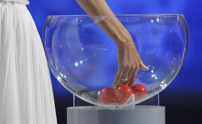 Presenter Natalia Vodianova starts the play-off drawn during the preliminary draw for the 2018 FIFA World Cup at Konstantin Palace in St. Petersburg, Russia July 25, 2015. REUTERS/Maxim Shemetov