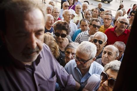 Pensioners wait to be allowed into the National Bank of Greece to withdraw a maximum of 120 euros ($134) for the week, Thursday, July 2, 2015. Greece braced for more chaos on the streets outside its mostly shuttered banks Thursday, as Athens and its creditors halted talks on resolving the country's deepening financial crisis until a referendum this weekend. AP