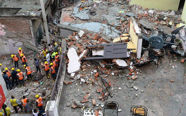 Personnel of the National Disaster Response Force and other officials clearing the rubble of a four-storey building that collapsed on Saturday, in New Delhi, on Sunday.  Rescuers found a girlu0092s body on Sunday, taking the toll in the building collapse to five. Photo: AFP
