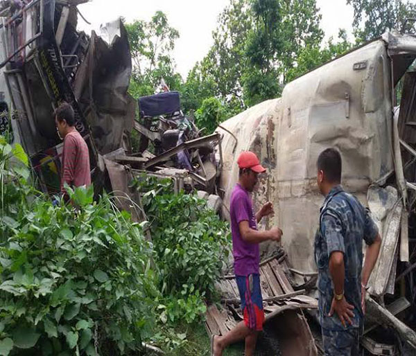 A passenger bus and a truck that collided with each other in Nawalparasi on Friday, July 16, 2015. Photo: Shreeram Sigdel