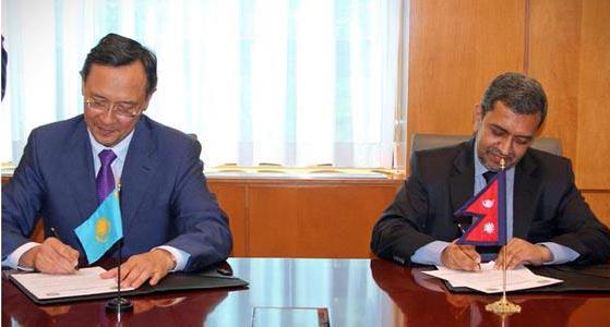Kazakh Ambassador Kairat Abdrakhmanov and Nepali Ambassador Durga Prasad Bhattarai signing the joint joint communiquu00e9u2019 on Tuesday, June 30, 2015.