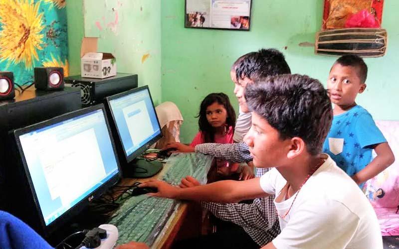 Children of Nepal Maitri Baal Orphanage using computers donated by Vijaya Dewan Gurung, a Los Angeles-based Nepali teacher, in Goldhunga, Kathmandu. Photo: THT
