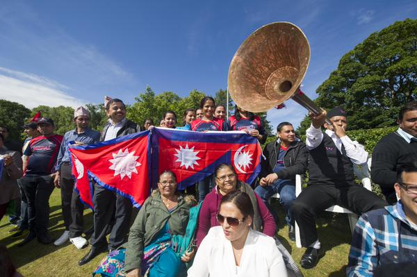 Nepalis in Scotland gather to support Nepal in the match against Scotland at Ayr. Photo: Cricket Scotland