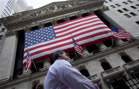 FILE - In this Monday, Aug. 8, 2011, file photo, a pedestrian walks past the New York Stock Exchange. Global stock markets were mostly higher Thursday, July 23, 2015, after Greece passed another bailout hurdle and New Zealand cut interest rates. AP