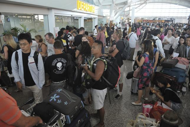 Passengers wait in the international terminal at Ngurah Rai Airport on the Indonesian resort island of Bali July 10, 2015 in this photo taken by Antara Foto. REUTERS/Nyoman Budhiana/Antara Foto