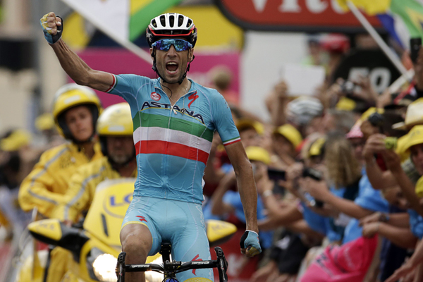 Italy's Vincenzo Nibali celebrates after winning the 19th stage of the 102nd Tour de France in La Toussuire on Friday. Photo:AFP