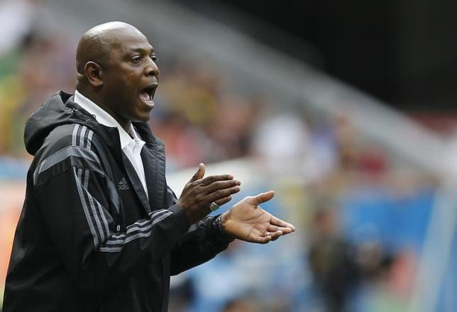 Nigeria's coach Stephen Keshi cheers on his team during their 2014 World Cup round of 16 game against France at the Brasilia national stadium in Brasilia June 30, 2014. REUTERS/Ueslei Marcelino