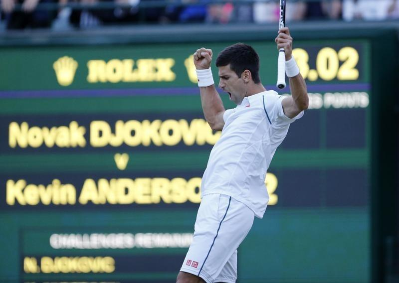 Novak Djokovic of Serbia celebrates after winning the second set during his match against Kevin Anderson of South Africa at the Wimbledon Tennis Championships in London, July 6, 2015.   REUTERS/Suzanne Plunkett