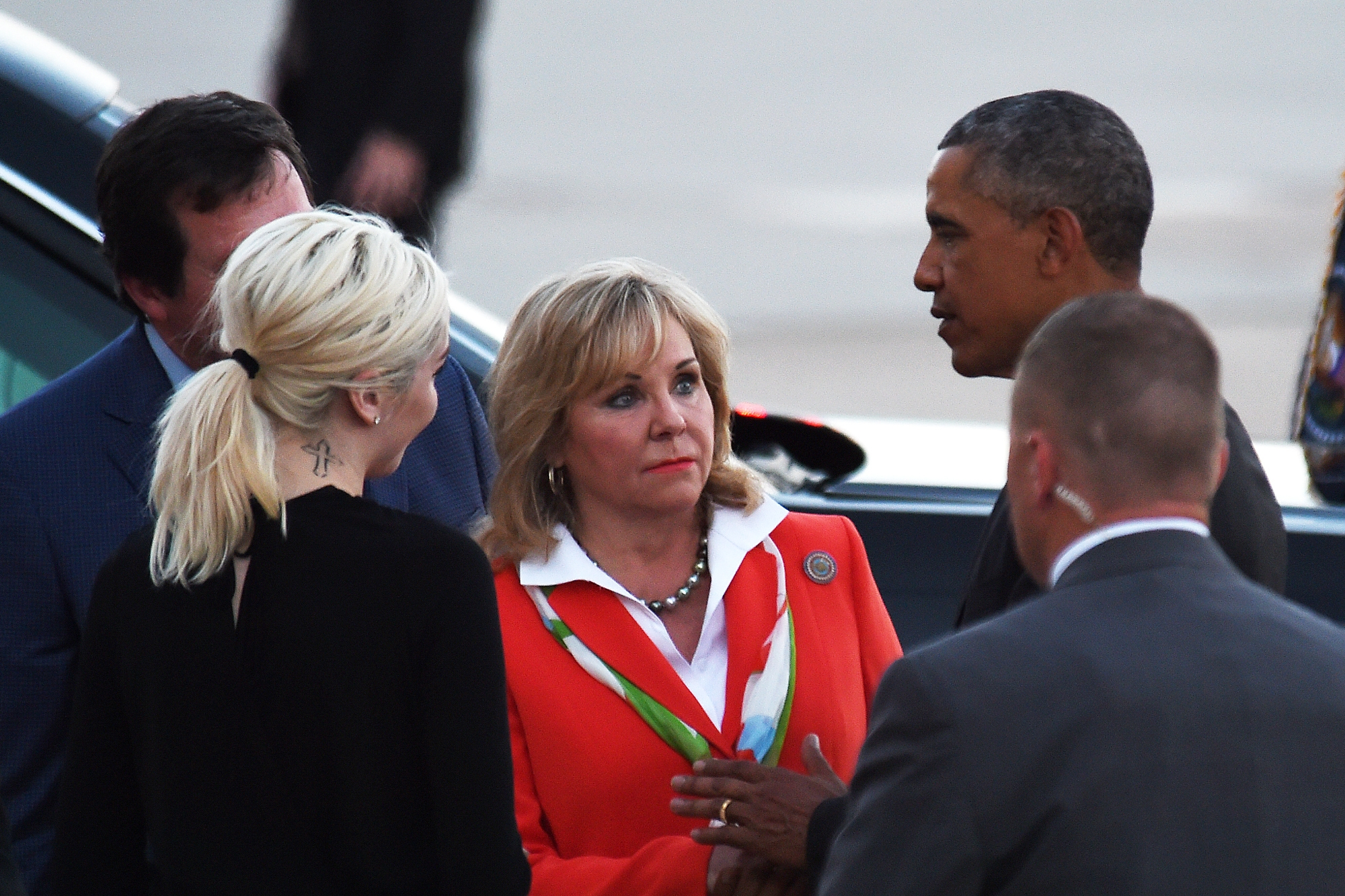 President Barack Obama, right, talks with Oklahoma Gov. Mary Fallin, center, after arriving at Tinker Air Force Base, Wednesday, July 15, 2015, in Oklahoma City, Okla. Photo: AP