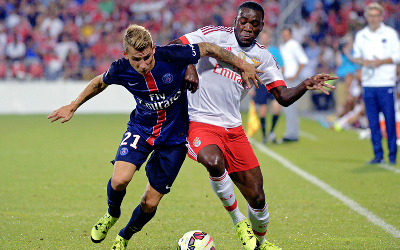 Benfica's Ola John (right) vies with PSGu0092s Lucas Digne during their International Champions Cup match in Toronto on Saturday. Photo: AP