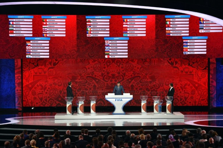 (L-R) Oliver Bierhoff, Jerome Valcke and Alexander Kerzhakov present the preliminary draw for the Union of European Football Associations zone for the 2018 World Cup qualifiers in Saint Petersburg on July 25, 2015. AFP