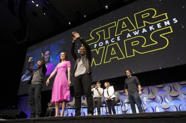 Star Wars: The Force Awakens cast members (L -R) Oscar Isaac, Daisy Ridley, John Boyega, writer, director and producer J.J. Abrams, producer Kathleen Kennedy and show host Anthony Breznican appear at the kick-off event of the Star Wars Celebration convention in Anaheim, California, April 16, 2015. The Star Wars Celebration runs through April 19 at the Anaheim Convention Center.  REUTERS/David McNew  - RTR4XNZ8