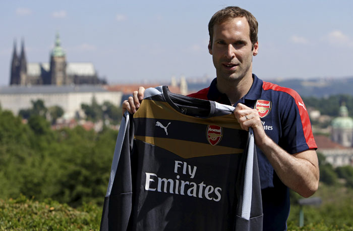 Czech Republic's goalkeeper Petr Cech presents his new Arsenal jersey after a press conference in Prague on Wednesday. Photo: AP