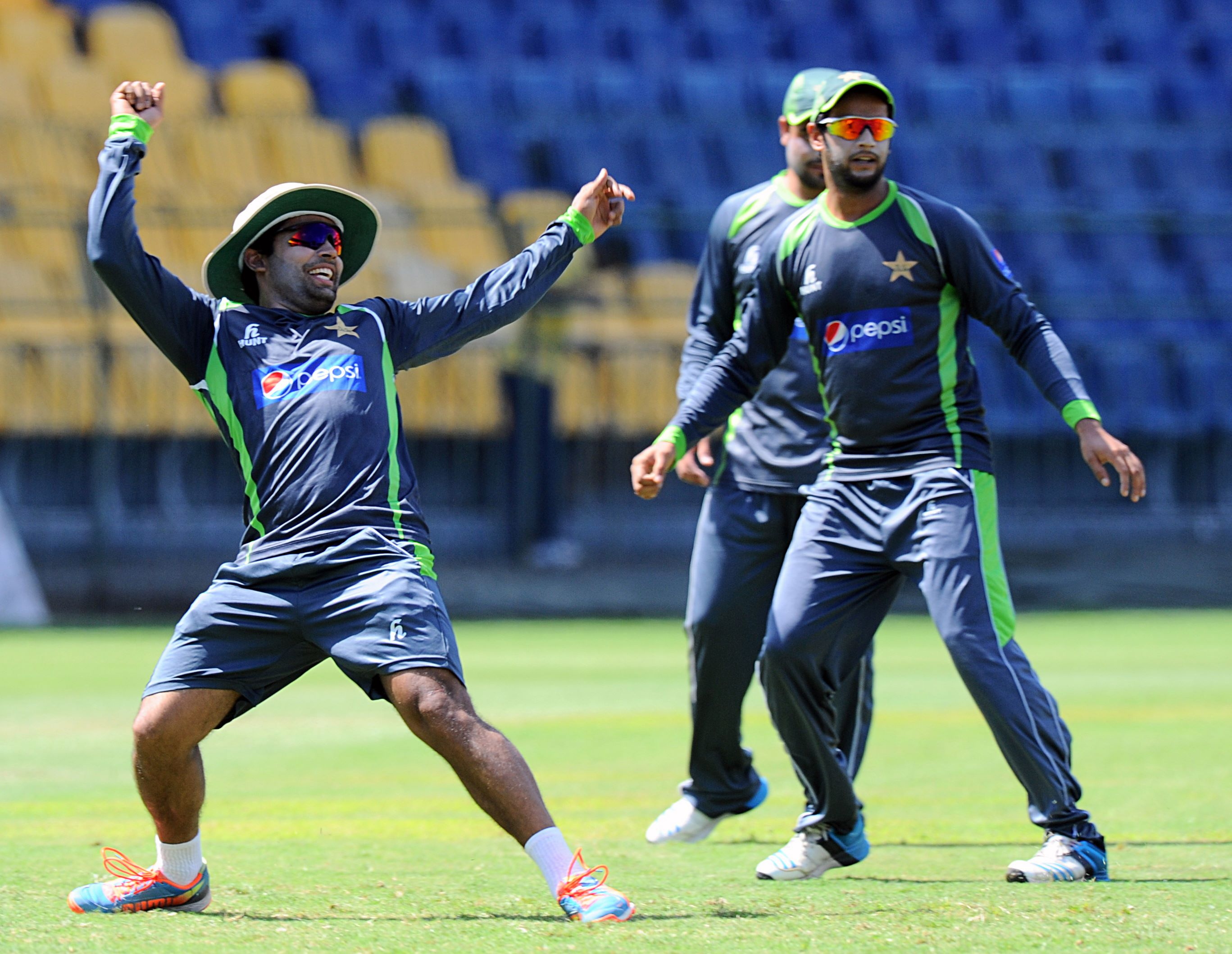 Pakistan's Umar Akmal (left) gestures as his teammate Imad Wasim looks on during a practice session at the R Premadasa International Cricket Stadium in Colombo on Wednesday. Sri Lanka will play their first T20 International match against Pakistan on Thursday. Photo: AFP