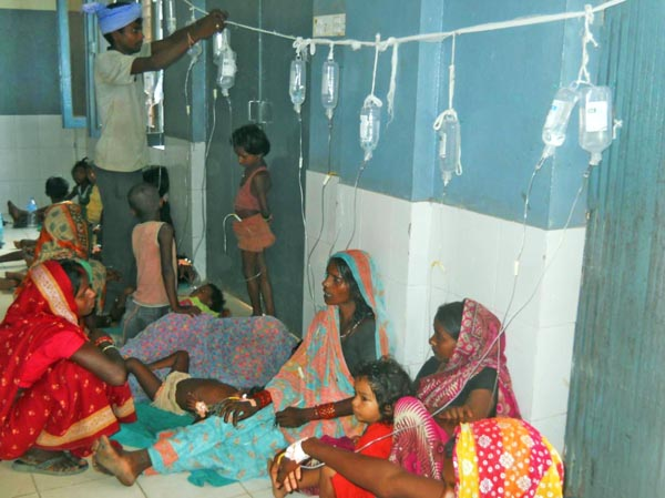 Patients being treated on the floor due to  lack of beds in Gajendra Narayan Singh Sagarmatha Zonal Hospital, Saptari, on Thursday.Photo:THT
