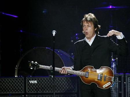 Paul McCartney, formerly a member of The Beatles, performs with his band during a concert at CitiField in New York in this July 17, 2009 file photo. REUTERS/Shannon Stapleton